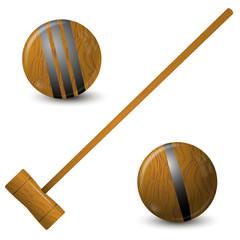 Wooden hammer and croquet balls