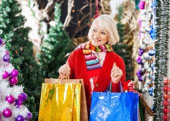 Beautiful Woman With Shopping Bags In Christmas Store