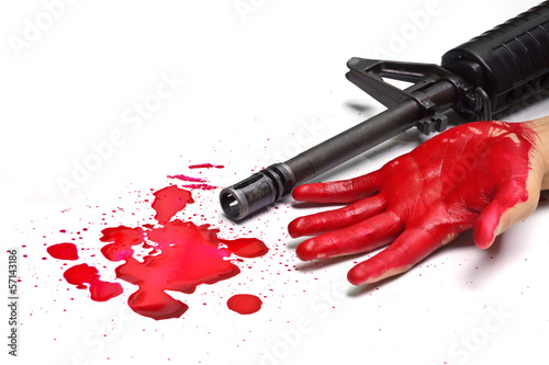 A rifle with bloody hands and blood drops