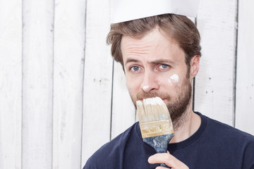 Caucasian man with a paint brush, renovation, painting walls