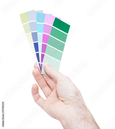 Man hand holding color samples isolated on white