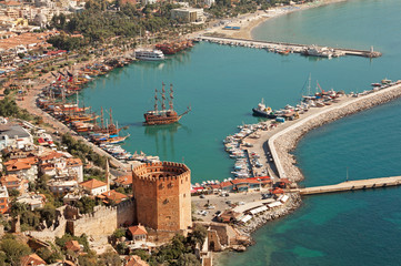 Alanya harbor and Kizil Kule tower. Turkey.