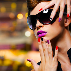 Woman with  fashion manicure and black sunglasses