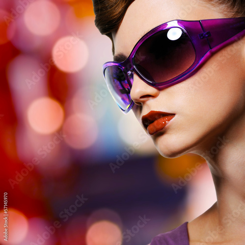 beautiful woman in fashion violet sunglasses