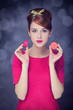 Redhead girl with macaron for St. Valentine Day.