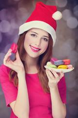 Redhead girl with macaron for Christmas