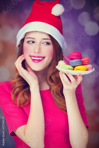 Redhead girl with macaron for Christmas
