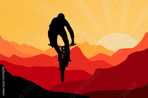 biker in mountains on sunrise