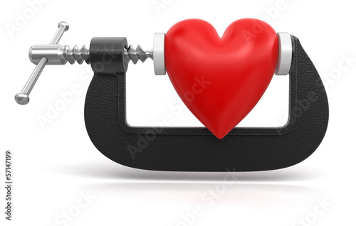 heart in clamp (clipping path included)