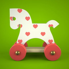 wood toy horse on green background
