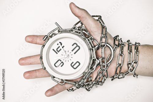 arm chained with a clock