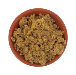 A portion of dark brown sugar in a small bowl