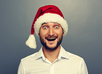 happy young man in christmas hat