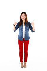 Portrait of young Asian student with thumbs up.