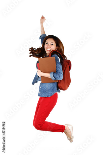 Portrait of young Asian student jumping with joy