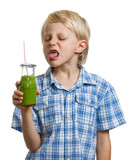 Boy poking tongue out at green smoothie poster