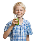 Cute boy with green smoothie oro juice