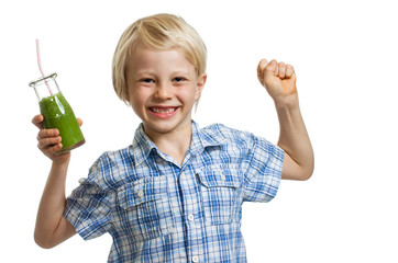 Boy with green smoothie flexing muscles
