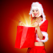 Surprised snow maiden with shopping bags with magic light