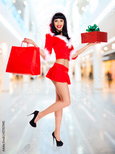 Snow maiden with shopping bags and box gift