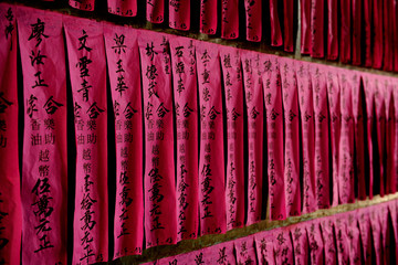 sheets of paper hanging in cultual pagoda
