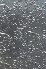 Silver tinfoill embossed background
