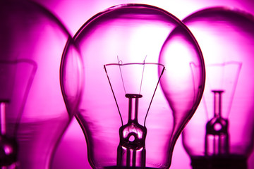 Row of light bulbs on a bright pink background