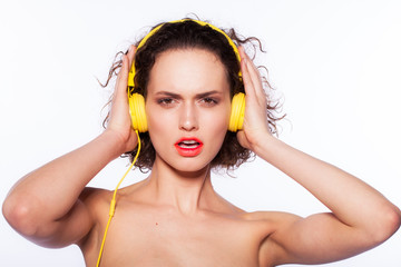 beautiful young woman wearing yellow headphones