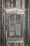 Wooden Shutters on Window of Old Building