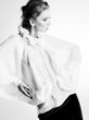 beautiful woman model in white elegant blouse posing dramatic