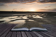 Creative concept pages of book Vibrant sunrise landscape reflect