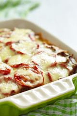 Casserole with meat, potato, tomato and cheese
