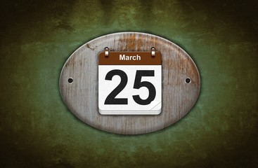 Old wooden calendar with March 25.