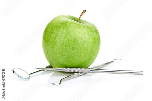 Green apple and dental tools isolated on white - 57170581