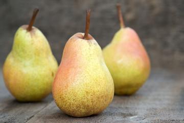 Fresh juicy pears in rustic wooden setting