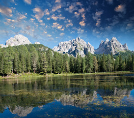 Beautiful alpin landscape. Mountain peaks reflected into a lake