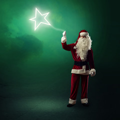 Santa Claus is holding a shining star