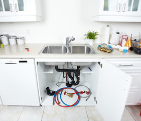 Kitchen sink pipes and drain. Plumbing.