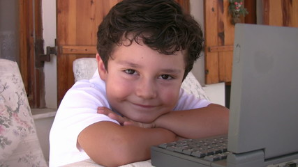 Little boy with computer