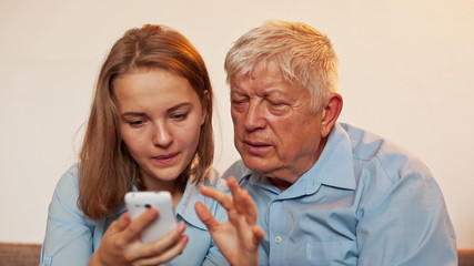 Young Girl and Old Person Learn Smartphone