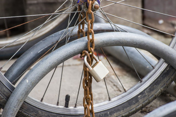 Lock and chain on a bicycle ,Close up view of a large lock and c