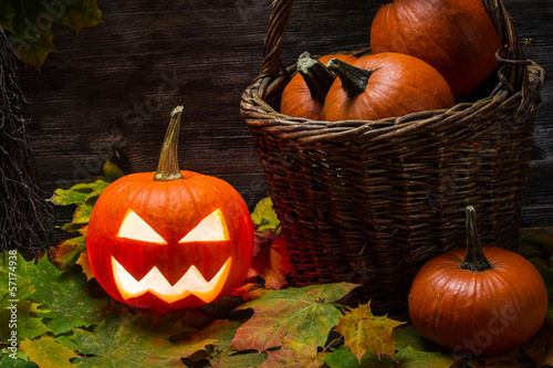 Pumpkins in wicker basket with leaves