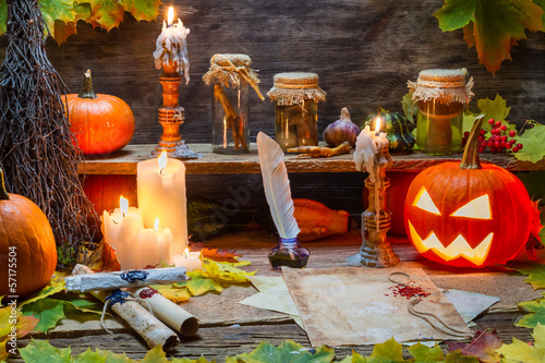 Old scrolls, pumpkin and candles on the halloween