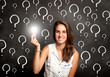 young woman holding a lightbulb with interrogation symbols