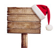 wooden sign with red Santa's hat