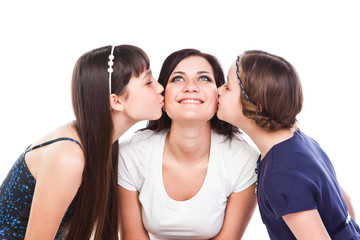 two beautiful daughters kiss their mother