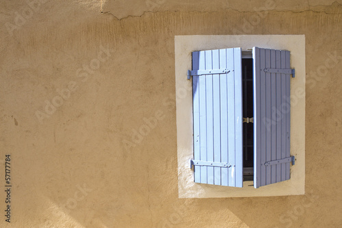 Shutter on wall, house in Provence.