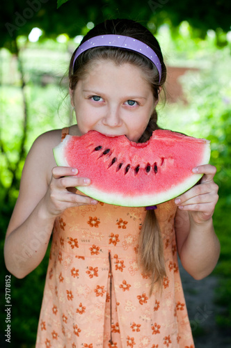 girl eating fresh watermelon