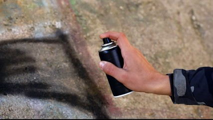 Teenager with color spray can near the wall episode 5