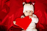 cute little baby with heart in hands